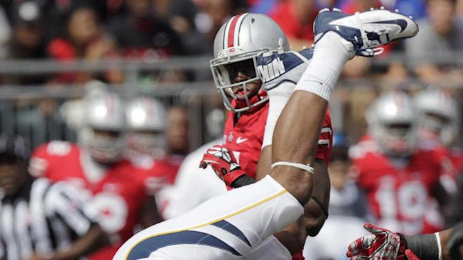 California's Keenan Allen is upended as Ohio State's Travis Howard looks on during the first quarter of an NCAA college football game Saturday, Sept. 15, 2012, in Columbus, Ohio. (AP Photo/Jay LaPrete)