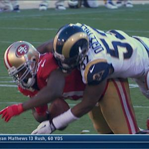 St. Louis Rams rookie linebacker Alec Ogletree forces San Francisco 49ers running back Frank Gore fumble