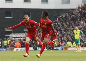 Liverpool's Sterling celebrates his goal against Norwich City with Lucas during their English Premier League soccer match at Carrow Road in Norwich