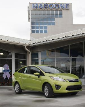 FILE - This Aug. 31, 2011 file photo, shows a Lime Squeeze Metallic 2012 Ford Fiesta SE at the Maroone Ford of Miami dealership in Miami. Ford Motor Company's U.S. retail sales rose 20 percent in November - the largest year-over-year increase in nine months. (AP Photo/Wilfredo Lee, File)
