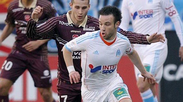 Marseille's Mathieu Valbuena (R) challenges Loris Nery of Valenciennes (Reuters)