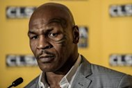 Former heavyweight boxing champion Mike Tyson, seen here, was granted a visa to Australia but warned he must behave, a week after the convicted rapist was denied entry to New Zealand