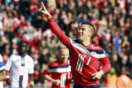 Lille's Eden Hazard celebrates after he scored a penalty during their French Ligue 1 soccer match against Toulouse at Lille Metropole Stadium in Villeneuve d'Ascq