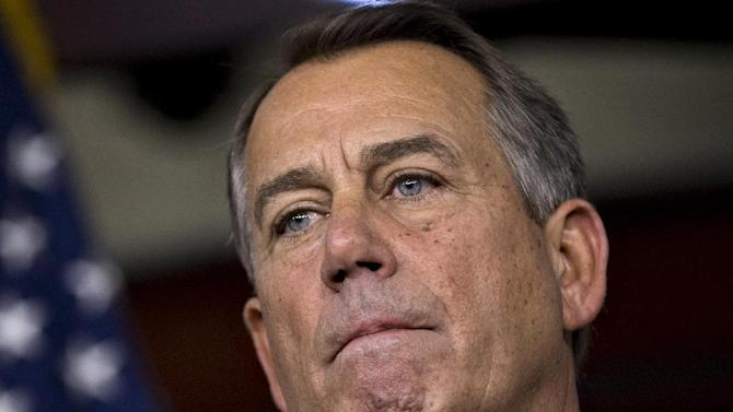 FILE - In this Dec. 21, 2012 file photo, Speaker of the House John Boehner, R-Ohio, speaks to reporters about the fiscal cliff negotiations at the Capitol in Washington. There's a growing sense of resignation that the country's political leaders will be unable or unwilling to find a way around looming automatic spending cuts despite fresh signs the cuts would threaten the recovering economy. (AP Photo/J. Scott Applewhite)