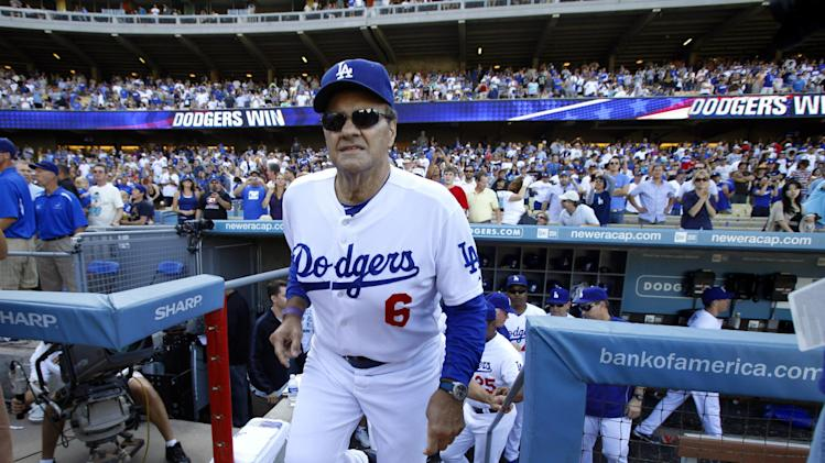 FILE - In this Oct. 3, 2010, file photo, then-Los Angeles Dodgers manager Joe Torre walks up the steps after a baseball game against the Arizona Diamondbacks in Los Angeles. Torre is returning to the top step of the dugout to manage the Americans at the World Baseball Clasic. Team USA have yet to even reach the championship game of this hugely popular international event played every three years. (AP Photo/Jae C. Hong, File)