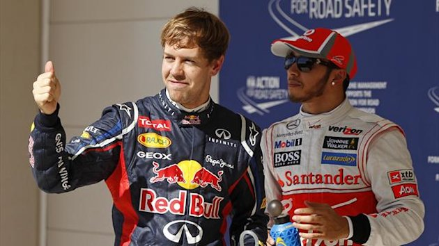 Red Bull Formula One driver Sebastian Vettel of Germany (L) gives a thumbs-up next to McLaren Formula One driver Lewis Hamilton of Britain following the qualifying session of the U.S. F1 Grand Prix at the Circuit of the Americas in Austin, Texas (Reuters)