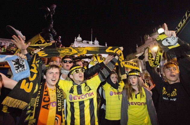 Borussia Dortmund fans gather at Piccadilly Circus in London after their team lost 2-1 against Bayern Munich during the Champions League Final match at Wembley Stadium
