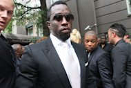 "Sean ""Diddy"" Combs, second from left, leaves the Frank E. Campbell Funeral Chapel following the service for hip-hop mogul Chris Lighty, Wednesday Sept. 5, 2012 in New York. Mourners in the packed chapel Wednesday included Sean ""Diddy"" Combs, Missy Elliott, Q-Tip, LL Cool J, Russell Simmons, 50 Cent and Grandmaster Flash. Lighty, the 44-year-old hip-hop mogul, was found dead in his Bronx apartment last week with a gunshot wound to the head. (AP Photo/Tina Fineberg)"