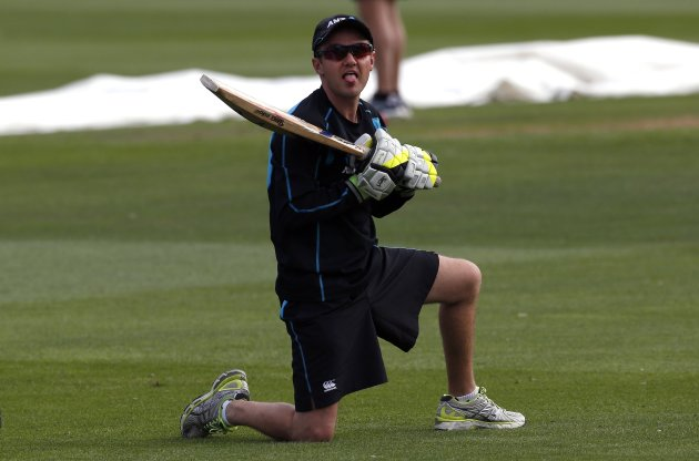 New Zealand cricket team coach Mike Hesson reacts as he hits balls during catching practice at a team training session at the University Oval in Dunedin