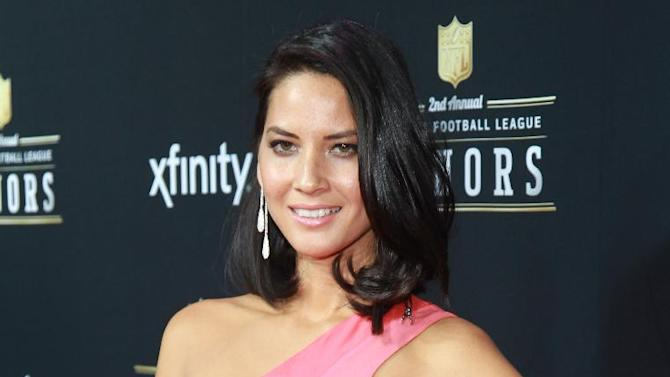 Actress Olivia Munn arrives at the 2nd Annual NFL Honors, on Saturday, Feb. 2. 2013 in New Orleans (Photo by Dario Cantatore/Invision/AP)