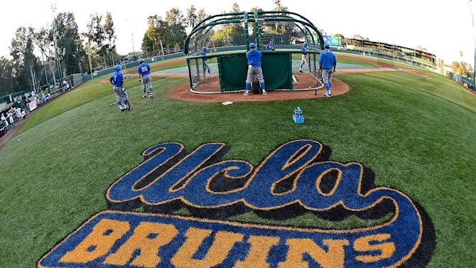 UCLA players take batting practice at Jackie Robinson Stadium before their NCAA college baseball tournament regional game against Maryland in Los Angeles, Monday June 1, 2015. (AP Photo/Jayne Kamin-Oncea)