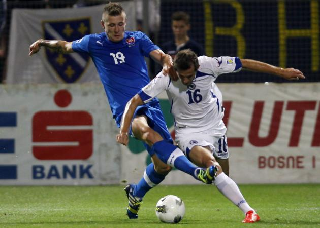 Bosnia's Lulic fights for the ball with Slovakia's Kucka during their 2014 World Cup qualifying soccer match in Zenica