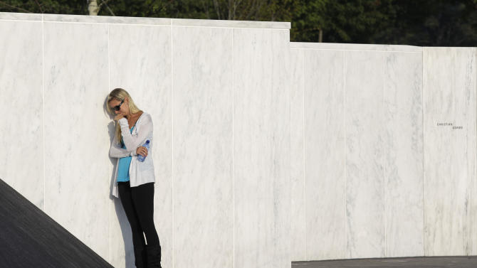 A bereaved family member mourns near the Wall of Names near the crash site of Flight 93 in Shanksville, Pa. Sunday Sept. 11, 2011.  (AP Photo/Amy Sancetta)