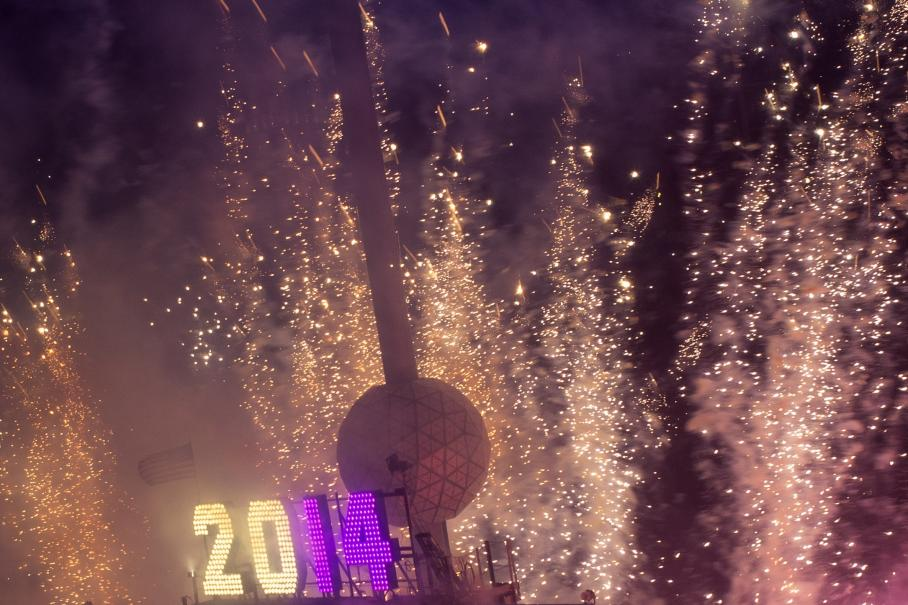 Fireworks explode past the Times Square Ball after it dropped to signal the start of the new year in Times Square, Midtown, New York