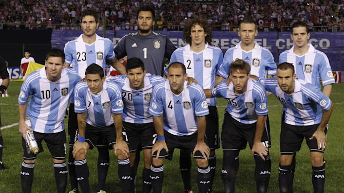 FILE- In this Sept. 10, 2013 file photo, Argentina soccer team poses prior to the start the World Cup qualifying soccer match between Argentina and Paraguay in Asuncion, Paraguay. Background from left: Jose Basanta, Sergio Romero, Fabricio Coloccini, Hugo Campagnaro and Fernando Gago. Foreground from left: Lionel Messi, Angel Di Maria, Sergio Aguero, Pablo Zabaleta, Lucas Biglia and Rodrigo Palacio
