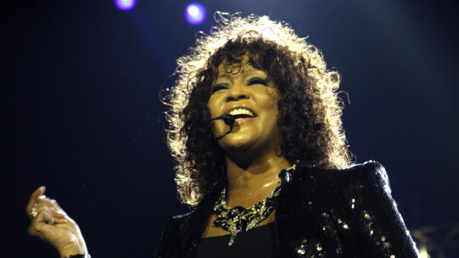FILE - In this April 25, 2010 file photo, singer Whitney Houston performs at the o2 in London as part of her European tour. Coroner's officials said Thursday, March 22, 2012, that Houston drowned, but her death was also caused by heart disease and cocaine use that suggested she was chronically using the drug. Houston died Feb. 11, in California at the age of 48. (AP Photo/Joel Ryan, file)