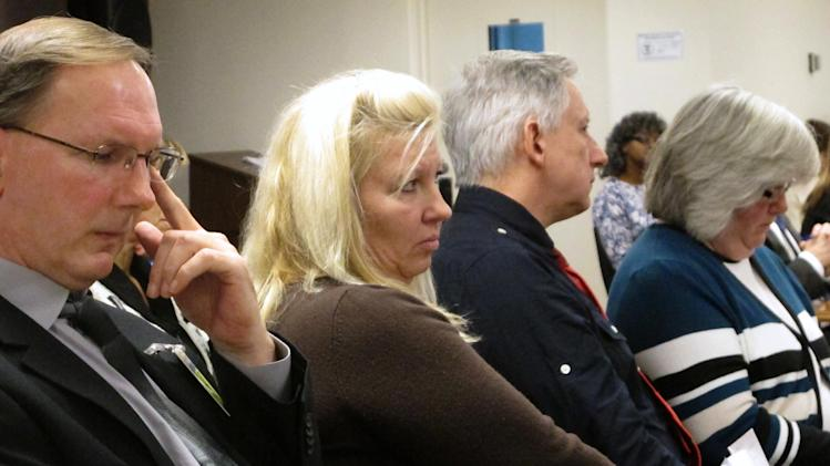 Left to right, William Vantz, the son of murder victim Helen Vantz;  Mary Cheriki, Helen Vantz' niece; and Michael Vantz, another son of Helen Vantz, listen to arguments at a clemency hearing for Ronald Post, Helen Vantz' killer, on Thursday, Dec. 6, 2012, at the Ohio Parole Board in Columbus, Ohio.  (AP Photo/Andrew Welsh-Huggins)