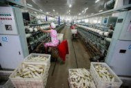 Chinese women are seen working at a cotton thread factory in Huaibei, in eastern China&#39;s Anhui province. China&#39;s industrial output grew at a slower-than-expected 9.6 percent year-on-year in May, a faster clip than the previous month but still near three-year-lows, according to the latest government data