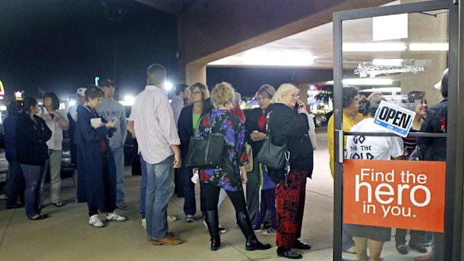 Volunteers at the United Blood Services line up to give blood after a parade float carrying wounded veterans and their families was struck by a train Thursday, Nov. 15, 2012, killing four and injuring 17, in Midland, Texas. (AP Photo/Reporter-Telegram, James Durbin)