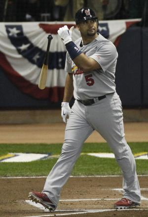 St. Louis Cardinals' Albert Pujols tosses his bat after hitting a two-run home run during the first inning of Game 2 of baseball's National League championship series against the Milwaukee Brewers Monday, Oct. 10, 2011, in Milwaukee. (AP Photo/Jeff Roberson)