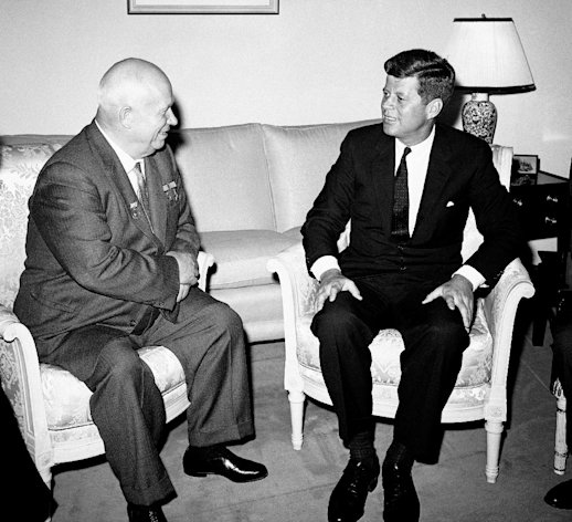 "FILE - In this June 3, 1961, file photo, Soviet Premier Nikita Khrushchev and President John F. Kennedy talk in the residence of the U.S. Ambassador in a suburb of Vienna. The meeting was part of a series of talks during their summit meetings in Vienna. Fifty years after the Cuban missile crisis, the National Archives in Washington has pulled together documents and secret White House recordings to show the public how President John F. Kennedy deliberated to avert nuclear war. The exhibit opens Friday, Oct. 12, 2012, to recount the showdown with the Soviet Union. It is called ""To the Brink: JFK and the Cuban Missile Crisis."" (AP Photo)"