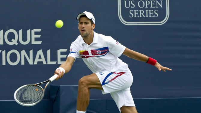 Novak Djokovic, from Serbia, returns to Marin Cilic, from Croatia, during the Rogers Cup men's tennis tournament Thursday, Aug. 11, 2011, in Montreal. Djokovic won 7-5, 6-2. (AP Photo/The Canadian Press, Paul Chiasson)