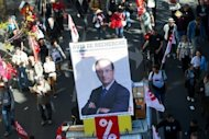 Protesters hold a placard bearing an image of French President Francois Hollande during a rally in Paris in September 2012 against austerity measures and the European budgetary treaty. EU leaders Thursday vowed to set up a banking union during the course of 2013 after a Franco-German spat held up agreement on exactly when this vital crisis-fighting tool might come into force