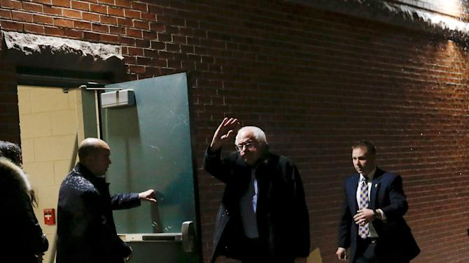 Democratic U.S. presidential candidate Bernie Sanders  waves upon arriving for a rally in Derry