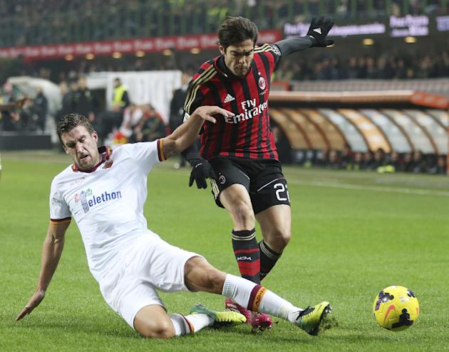 AC Milan Brazilian forward Kaka, right, is tackled by AS Roma midfielder Kevin Strootman, of the Netherlands, during the Serie A soccer match between AC Milan and Roma at the San Siro stadium in Milan