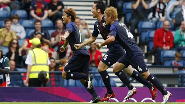 Japan&#39;s Yuki Otsu celebrates his shock winner against Spain
