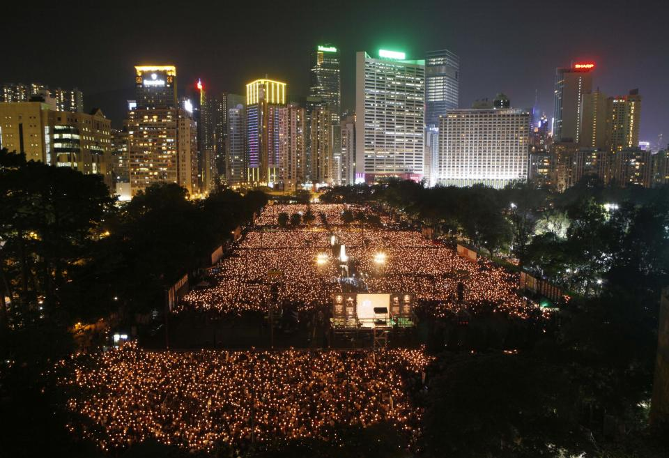 Tens of thousands of people attend a candlelight vigil at Hong Kong's Victoria Park Monday, June 4, 2012 to mark the 23rd anniversary of the Chinese military crackdown on the pro-democracy movement in Beijing. (AP Photo/Kin Cheung)