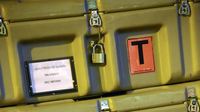 FOR STORY - EUROPE'S TRAVELING PARLIAMENT - Boxes belonging to various MEPs wait to be loaded on trucks for transportation from the European Parliament building in Brussels to Strasbourg in France, on Friday, Feb. 1, 2013.   The EU set up two parliaments, one at headquarters in Brussels, Belgium, and the other in Strasbourg, France, so in a whirl of trunks, trolleys and backpacks, hundreds of European Union parliamentarians and their staff move some 350-kilometer (220-mile) across the continent for four days of meetings, at an annual cost of about euro 1.3 billion (US dlrs 1.8 billion). (AP Photo/Thierry Charlier)