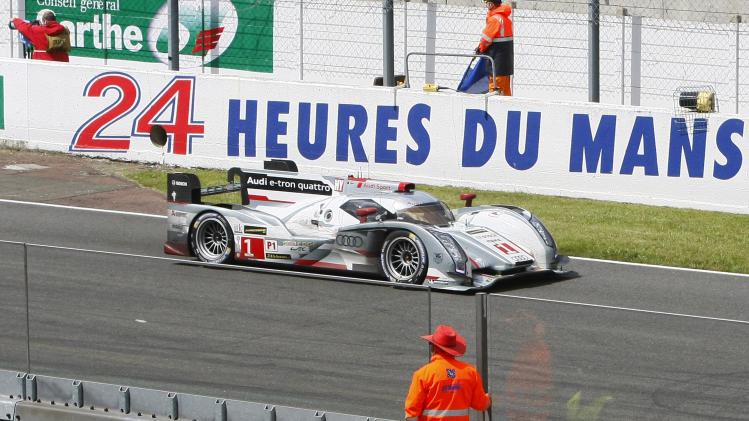 The Audi R18 E-Tron No1 driven by Andre Lotterer of Germany, Marcel Fassler of Switzerland and Benoit Treluyer of France in action during the 90th 24-hour Le Mans endurance race, in Le Mans, western France, Sunday, June 23, 2013. (AP Photo/Michel Spingler)