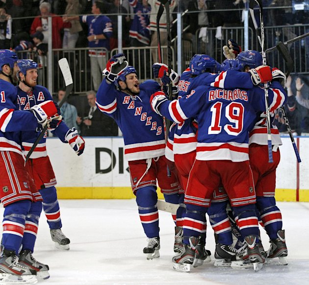 New York Rangers players celebrate after defeating the Washington Capitals 2-1 in Game 7 of a second-round NHL hockey Stanley Cup playoff series at Madison Square Garden in New York, Saturday, May 12,