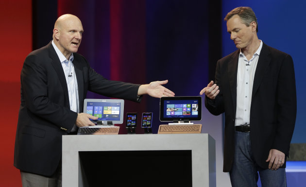 Microsoft CEO Steve Ballmer, left, and Qualcomm CEO Paul Jacobs talk about various Windows based products that utilize Qualcomm technology during Jacobs' keynote address at the Consumer Electronics Show, Monday, Jan. 7, 2013, in Las Vegas. (AP Photo/Julie Jacobson)