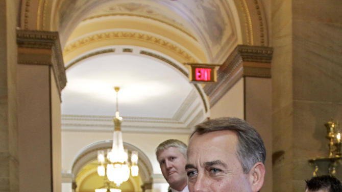 Speaker of the House John Boehner, R-Ohio, returns to his office from the House floor as the debt crisis showdown continues on Capitol Hill in Washington, Saturday, July 30, 2011.  (AP Photo/J. Scott Applewhite)