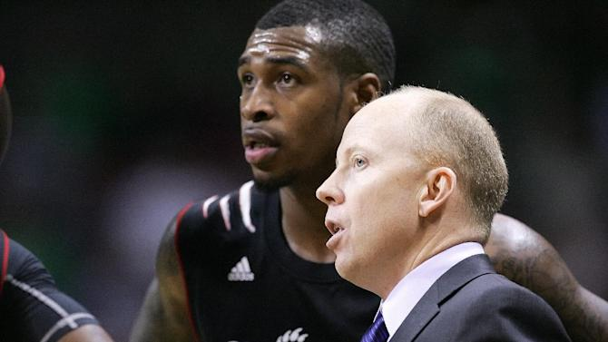 Cincinnati head coach Mick Cronin, right, gives instructions to Sean Kilpatrick during an NCAA college basketball against Marshall on Saturday, Dec. 15, 2012, in Charleston, W.Va. Kilpatrick scored 13 points in the Bearcats' 72-56 victory. (AP Photo/Randy Snyder)