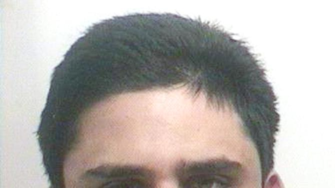 In this mug shot released by the Florida Highway Patrol shows James Seevakumaran on October 30, 2006. University of Central Florida police have identified Seevakumaran as the student that killed himself in a dorm at UCF in Orlando, Fla. ,early Monday March 18, 2013. Seevakumara was found with several fire arms and a homemade device in a backpack. The incident caused the evacuation of a dorm building. (AP Photo/Florida Highway Patrol)