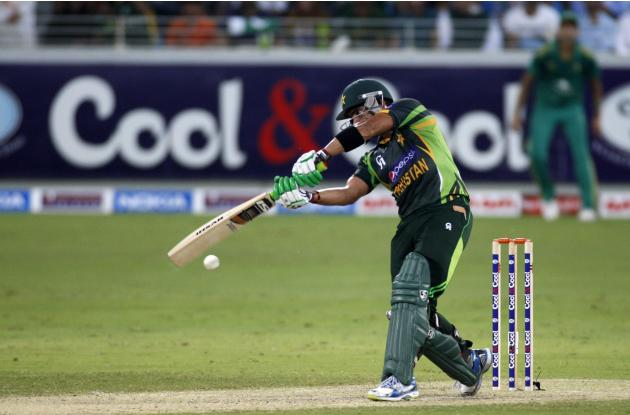 Pakistan's Umar Akmal plays a shot during their first Twenty20 international cricket match against South Africa in Dubai
