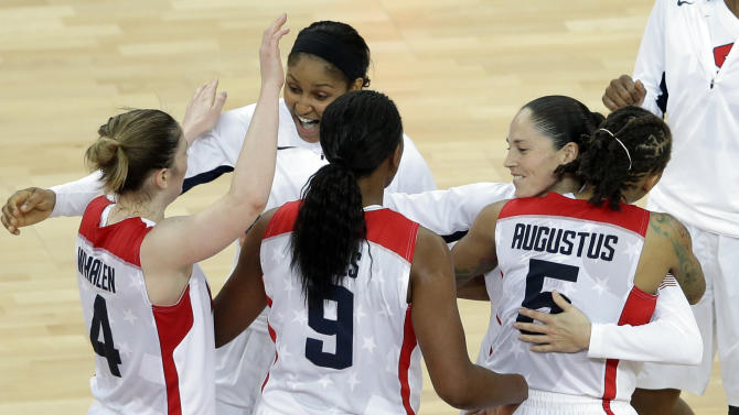 United States' players celebrate after defeating France in the women's gold medal basketball game at the 2012 Summer Olympics, Saturday, Aug. 11, 2012, in London. (AP Photo/Victor R. Caivano)