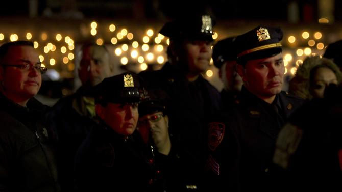 Police officers line up late into the evening for the wake for NYPD officer Rafael Ramos at Christ Tabernacle Church in the Queens borough of New York