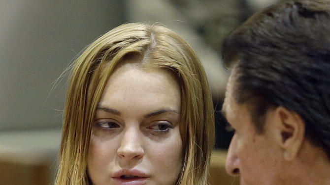 Actress Lindsay Lohan, left, and attorney Mark Heller appear at a hearing in Los Angeles Superior Court Monday, March 18, 2013. Lohan accepted a plea deal on Monday in a misdemeanor car crash case that includes 90 days in a rehabilitation facility. The actress, who has struggled for years with legal problems, pleaded no contest to reckless driving, lying to police and obstructing officers who were investigating the accident involving the actress in June. (AP Photo/Reed Saxon, Pool)