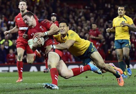 Australia's Folau fails to stop Wales's North from scoring a try during their international rugby union match in Cardiff