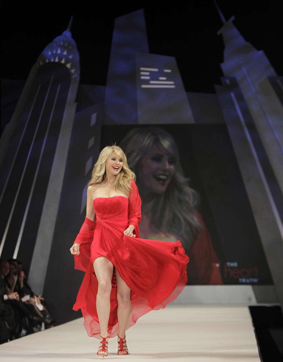 Christie Brinkley models Pamella Roland during the Heart Truth Red Dress fashion show in New York, Wednesday, Feb. 8, 2012.  (AP Photo/Kathy Willens)