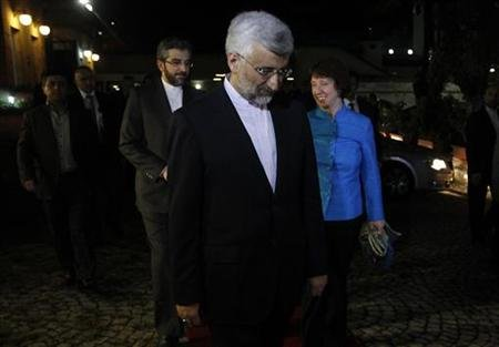 EU foreign policy chief Catherine Ashton (R) and Iran's chief negotiator Saeed Jalili (C) walk before their meeting in the garden of the Iranian Consulate in Istanbul September 18, 2012.