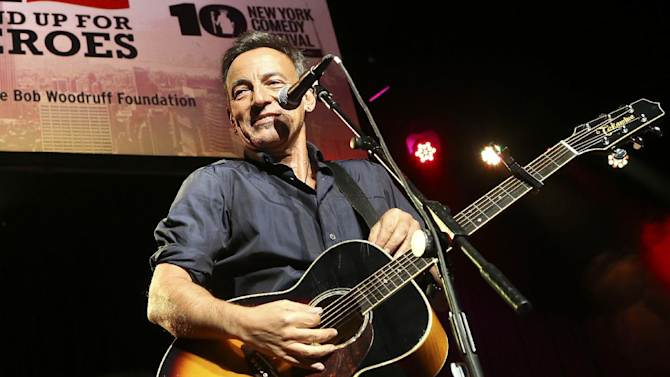 "FILE - In this Nov. 6, 2013 file photo, musician Bruce Springsteen performs at the Stand Up for Heroes event at Madison Square Garden, in New York. Springsteen, Metallica, Eminem, and Rihanna are among the artists booked to play a televised live concert from the National Mall in Washington next month to raise awareness of issues concerning veterans. ""The Concert for Valor"" is planned for 7 p.m. ET on Veteran's Day, Nov. 11. (John Minchillo/Invision/AP, file)"