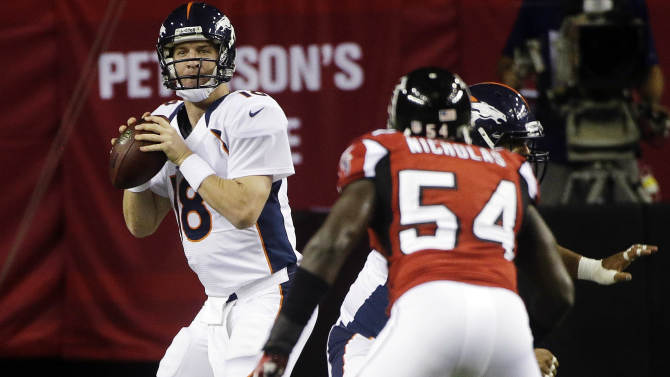 Denver Broncos quarterback Peyton Manning (18) looks for an open receiver against the Atlanta Falcons during the first half of an NFL football game, Monday, Sept. 17, 2012, in Atlanta. (AP Photo/John Bazemore)