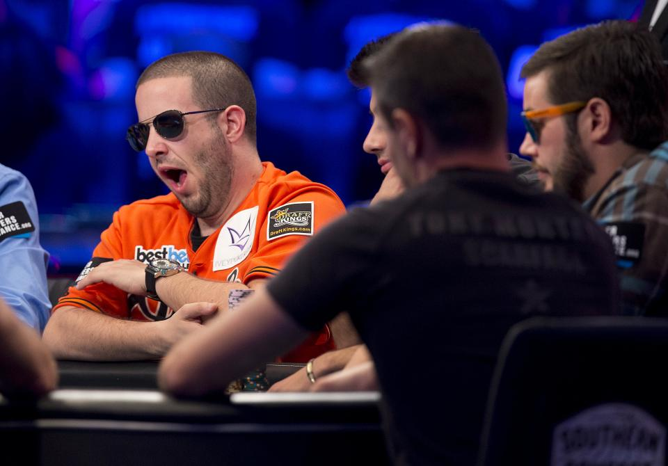 Greg Merson, left, of Laurel, Md., yawns during the World Series of Poker Final Table event, Monday, Oct. 29, 2012, in Las Vegas. (AP Photo/Julie Jacobson)