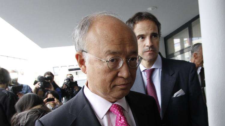 "Director General of the International Atomic Energy Agency, IAEA, Yukiya Amano from Japan returns from Iran at the Vienna International Airport near Schwechat, Austria, on Tuesday, May 22, 2012. Amano says he has reached a deal with Iran on probing suspected work on nuclear weapons and adds that the agreement will ""be signed quite soon."" (AP Photo/Ronald Zak)"
