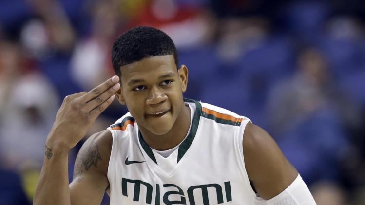 Miami's Rion Brown (15) reacts after making a basket against Boston College during the first half of an NCAA college basketball game at the Atlantic Coast Conference tournament in Greensboro, N.C., Friday, March 15, 2013. (AP Photo/Gerry Broome)